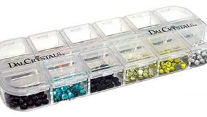 DalCrystal 3mm & 4mm kit BUNDLE of 3 assorted packs Dress up your embroidery designs, appliqués, or any type of apparel with these DalCrystal® kits.  These versatile kits come with assorted colours in each kit 12 Colours 20 of each in 3mm - 4mm  Each colour comes in 200 pieces organized in a handy clear plastic divided tray.  The tray keeps the crystals separated by colour and prevents them from scattering or getting lost. Dalcrystal hotfix adhesive rhinestone kits:  Colours in Assorted Mix: Amethyst Aquamarine Black Champagne Citrine Clear Cobalt Emerald Peridot Siam Sun Topaz  Colours in Spring Mix: Amethyst Aquamarine Champagne Citrine Peridot Sun  Colours in Winter Mix: Champagne Clear Cobalt Emerald Siam Topaz Limited stock available, an assorted mix will be shipped. ---------------------------------------------------------------------------------------------------------- A Wax Picker Pencil can replace tweezers for picking up the crystals and placing them in position. see other listing High Quality USA imported product.